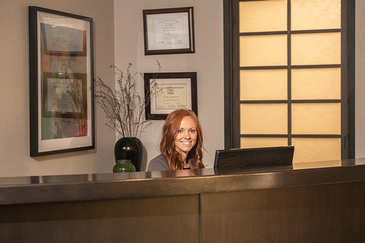 Smiling Staff at Aspen Dental Front Desk Denver CO