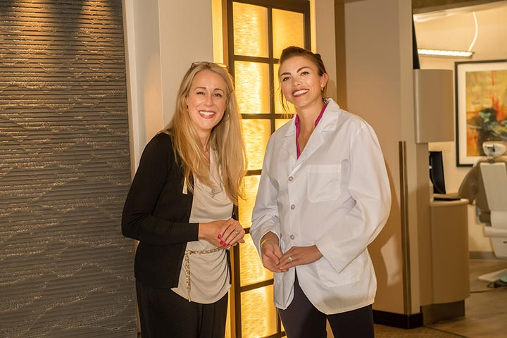 Dentist Dr. Elizabeth Turner Smiling with patient at Aspen Dental Denver CO